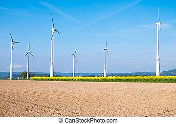 Barren field and windwheels - Many windwheels standing...