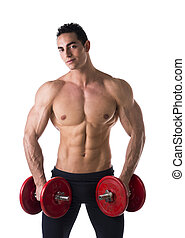 Happy muscular shirtless young man holding dumbbells