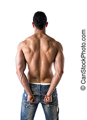 Back of muscular shirtless young man with handcuffs,...