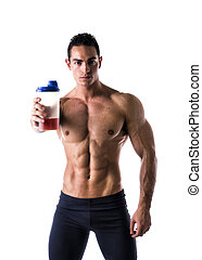 Muscular shirtless male bodybuilder holding protein shake...