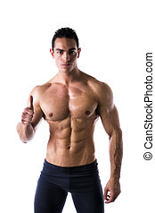 Muscular young man with thumb up doing OK sign - Shirtless...
