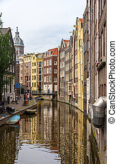 Canal in De Wallen district of Amsterdam