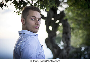 Profile shot of handsome young man outdoors
