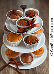 Different muffins in a vitrine. Chocolate and white muffins.