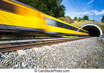 Fast train passing through a tunnel on a lovely summer day...