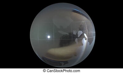 globe on background of human eyes