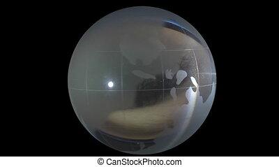 globe on background of human eyes