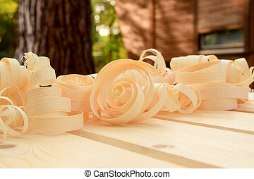 shavings on planks from the construction of a shed