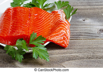 Fresh Fillet of Sockeye Salmon with parsley - Closeup...