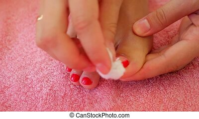 Close-up of Woman Removing Nail Polish from Her Legs. Before Pedicure.