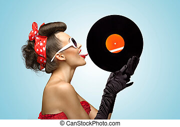 The vinyl desire - A photo of glamorous pin-up girl touching...