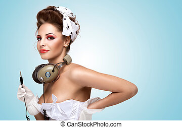 Pin-up party. - The pin-up photo of a retro girl with...