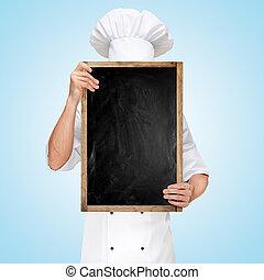 Menu chalkboard. - Restaurant chef hiding behind a blank...