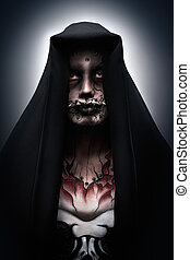 Darth Maul - A man covered with a hood in a creepy halloween...
