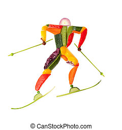 Skiing and fruits. - Fruits and vegetables in the shape of a...