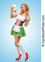 Serving at Oktoberfest - Young sexy Oktoberfest waitress...
