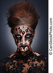 Blood lust. - A creepy female halloween makeup of a witch...