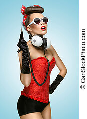 Pin-up party - The pin-up photo of a cute girl in sunglasses...