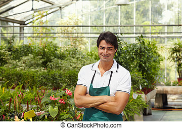 florist - portrait of male florist looking at camera with...