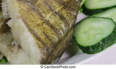 Sudak steamed Macro - Laid on lettuce leaves boiled fish...