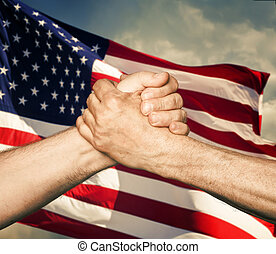 Patriotic concept. Handshaking. The USA flag and shaking...