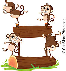 Monkeys playing with the empty signboard