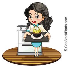 A woman baking a cupcake