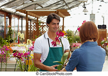 woman buying orchids