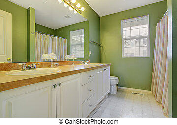 Bright green bathroom interior - Green bathroom with white...