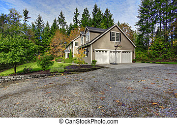House exterior. View of three car garage with driveway and...