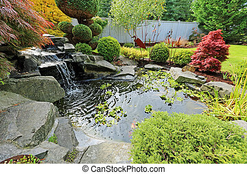 Home tropical garden with pond - Tropical landscape design...