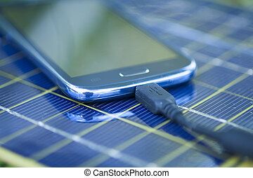 Charging mobile phone with solar charger - Solar Mobile...