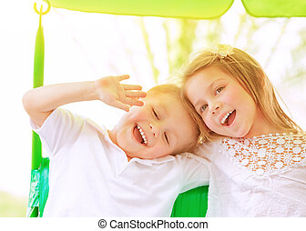 Adorable children on swing - Closeup portrait adorable...