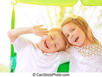 Adorable children on swing - Closeup portrait adorable...