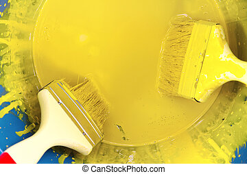 yellow paint can and brush