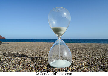 Hourglass on a Beach - One Hourglass on the Sand Beach Near...
