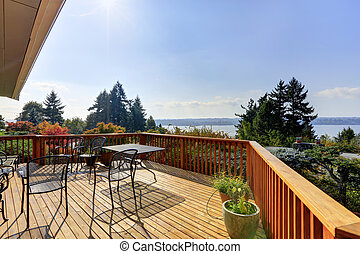 Wooden walkout deck with lake view