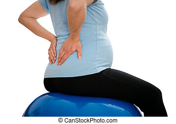 Pregnancy backache - Pregnant woman sitting on fit ball with...