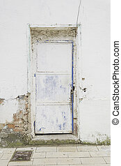 White door broken - Broken door with white brick wall,...