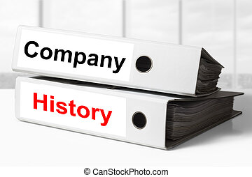 company history office binders - stack of two white office...