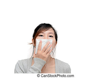 Sick woman blowing her nose isolated.