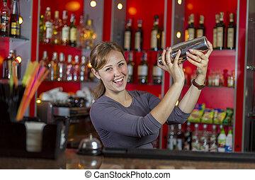 bartender makes cocktail - girl bartender makes a cocktail