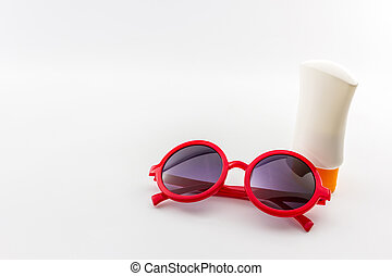 Red sunglasses with body lotion.