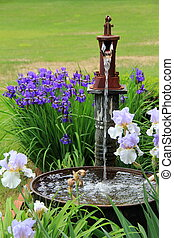 Waterfountain in colorful garden - Peaceful sound of running...