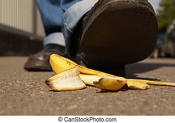 slipping on a banana peel - person about to slip on a banana...