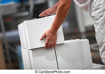 Manual worker working with boxes - Manual worker at...