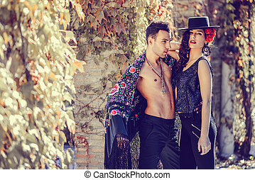 Beautiful couple, models of fashion, wearing spanish clothes...