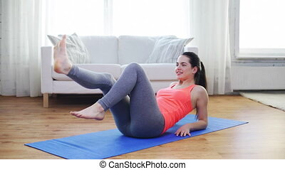 smiling teenage girl doing exercise for legs - fitness,...
