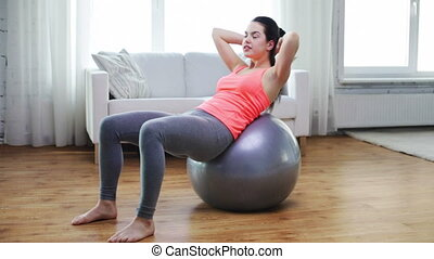 girl exercising with fitness ball at home - fitness,...