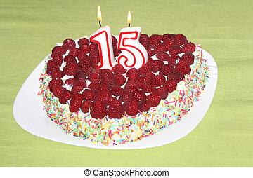 Birthday raspberry cake - Burning birthday candles number 15...